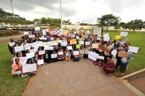 Staff at the US embassy in Nairobi hold up signs calling for the return of the missing Nigerian girls.